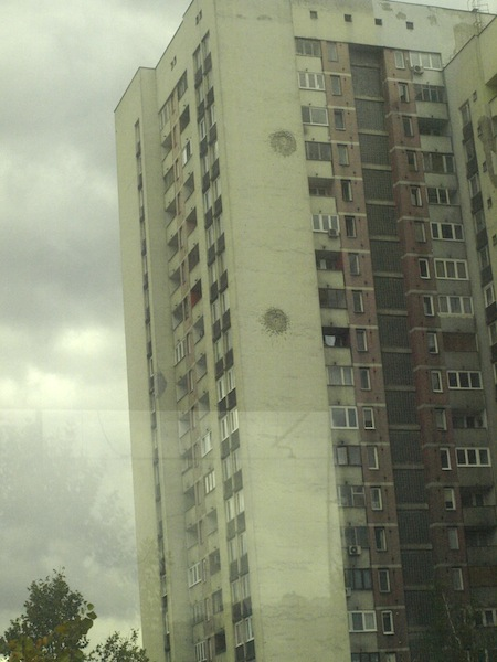 Highrise on the outskirts of Sarajevo with a couple of repaired shell holes.