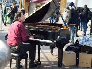 Near the Venice railway station there was this very serious busker. First time we have seen a busker on a grand piano.