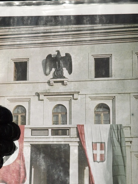 The eagle and swastika symbol on the front of Nazi headquarters during WW2.