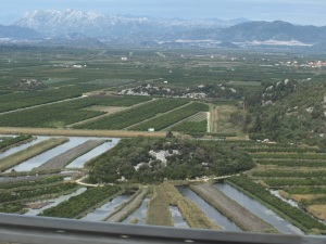 I'm not sure why the irrigation channels here are so wide. Note the snow on top of the distant mountains.
