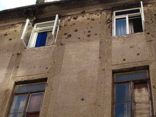 Bullet and shrapnel damage.
