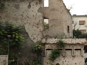 Bullet holes in a house wall.