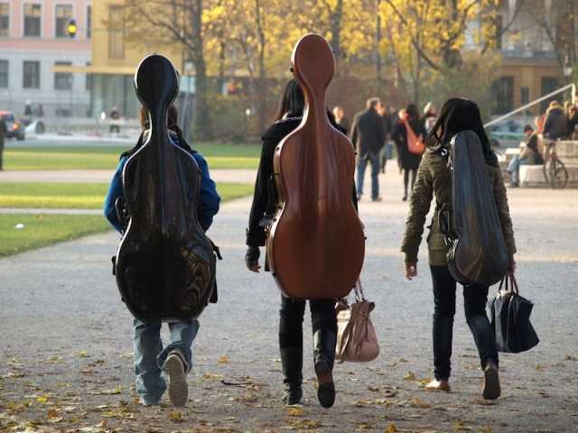 Music students from the university taking their instruments for a walk along the edge of the parade ground.