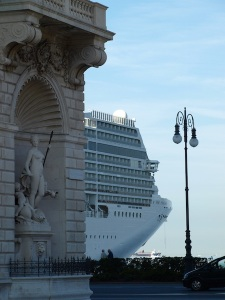 The corner stone of the Lloyd Triestino building and a huge cruise liner. The liner was flying a Blue Peter flag so it was getting ready to sail.