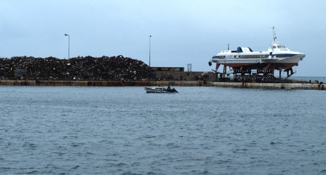 The stockpile to the left of the hydrofoil ferry is scrap metal.