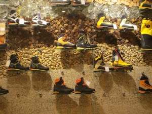 Outdoor boots and shoes display.