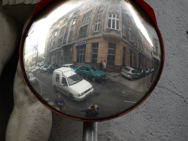 Wandering the streets of Sarajevo. Note the knee to the left of the mirror.