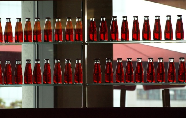 The contents of these bottles were not for drinking. The arrangement was simply a division between two shops.