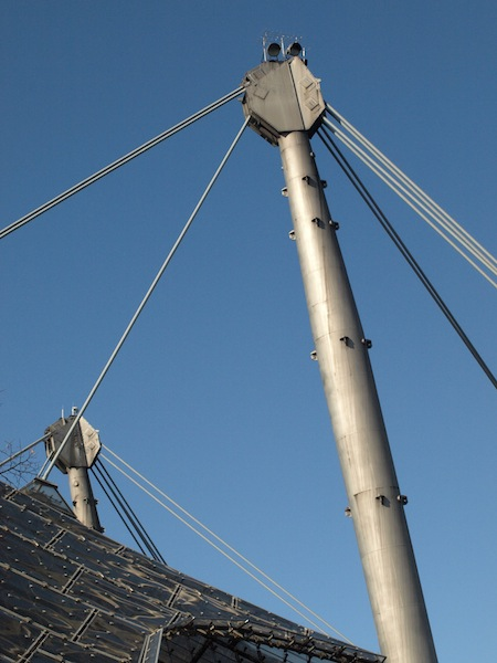 The chunky roof cable support masts.