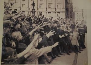 Enthusiastic followers giving the Nazi salute.
