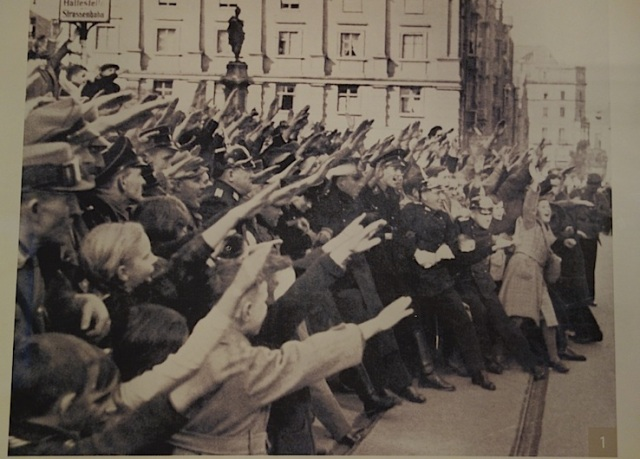 Enthusiastic followers giving the Nazi salute.