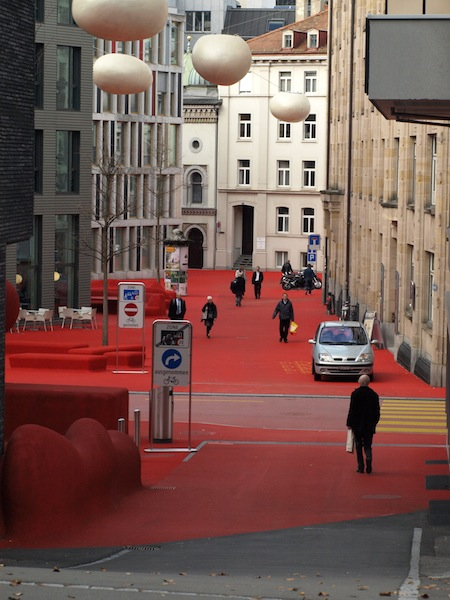 Rotplatz in St Gallen is covered with red carpet and the egg-shaped objects up high are actually streetlights.