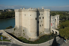 Chateau du Roi Rene (formely a castle fortress) with the River Rhone in the background. Image thanks to Wikipedia.