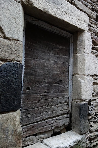 The black stone in the left door jamb could be black marble .