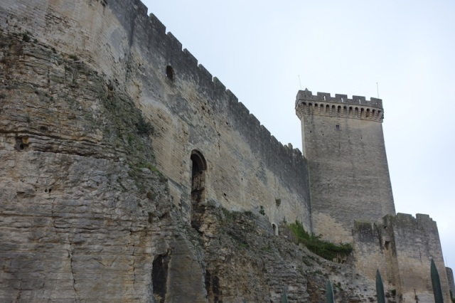 The notched battlements (crenelation) of the Beaucaire Castle.