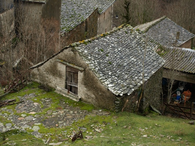Portion of a farmhouse (still being lived in) below the ruins.