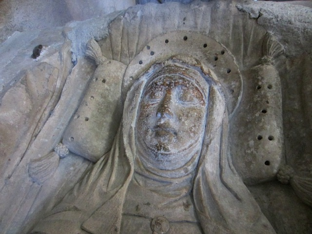 St Martha at rest. The dark stains on her face are where people have touched or kissed her over the centuries.