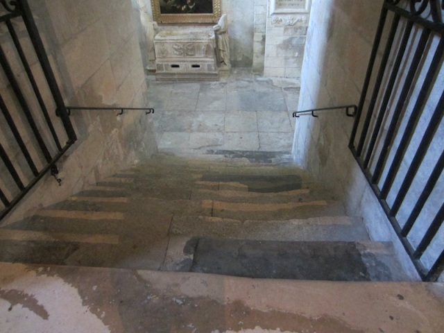Well-worn steps to St Martha's crypt.