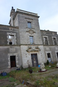 This grand villa was near the church. The wings were in ruin but the centre section was being lived in.