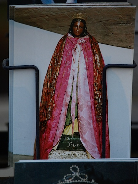 A postcard of a black Madonna.