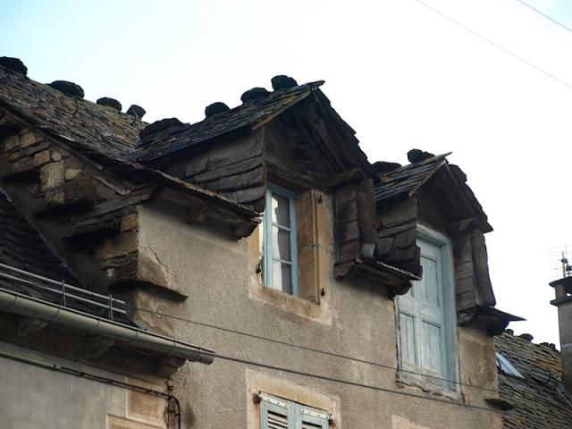 Slate roof and dormer windows.