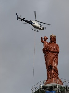 A spruced up Virgin Mary, Jesus waving me a blessing and the helicopter taking away scaffolding.
