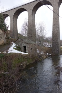The viaduct, towering over the village and rivulet.