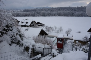 View from our Bremgarten house with snow. A small cablecar takes residents of the area up and down.