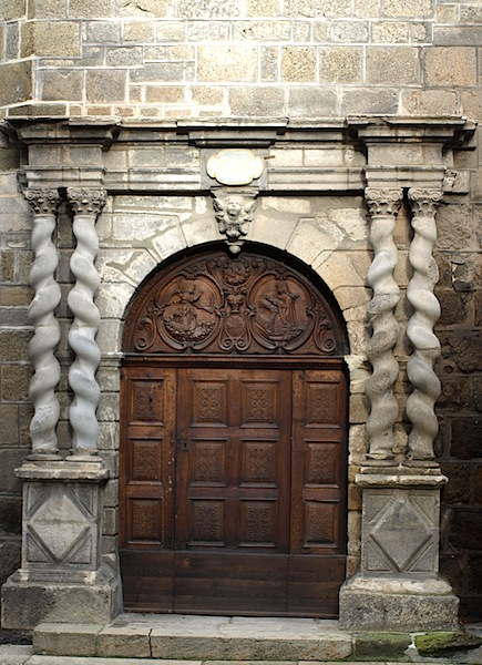 Left- and right-handed stone helical columns adorning a bas-relief door. Helical columns are also referred to as Solomonic or Barley-sugar columns.