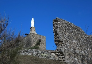 White Madonna keeping watch over the ruins of the Chateau de Luc.