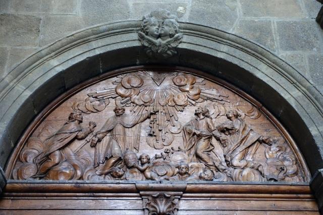 A circular arch encapsulating a bas-relief carving.