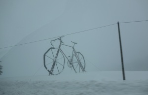 Mysterious giant bike in the snowstorm.