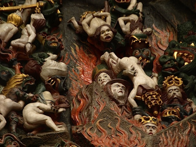 Sinners being thrown into the fires of Hell. Maybe the crowned figures are the corrupt kings and despots of centuries past.