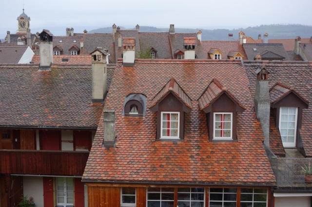 Chimneys and glazed tile roofs are the feature of houses in Murten.