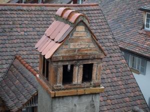 Solid tiled chimney cap.