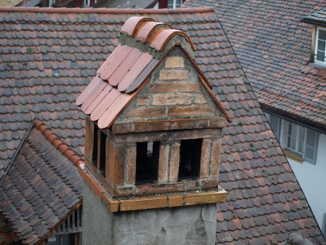 Solid tiled chimney cap.