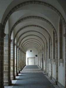 A colonnade outside the part of the abbey complex that houses a museum.