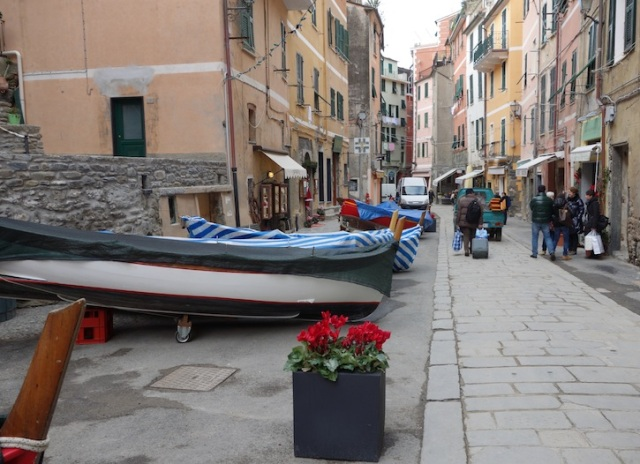 Most boats were under wraps for the winter. Bev was amazed that the cyclamens (red flowers in the black pot) were not put under cover for the winter.