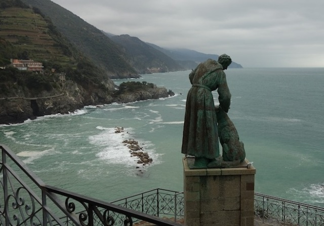 This is the view to the east from the headland. Capuchin monk St Francesco with his dog.