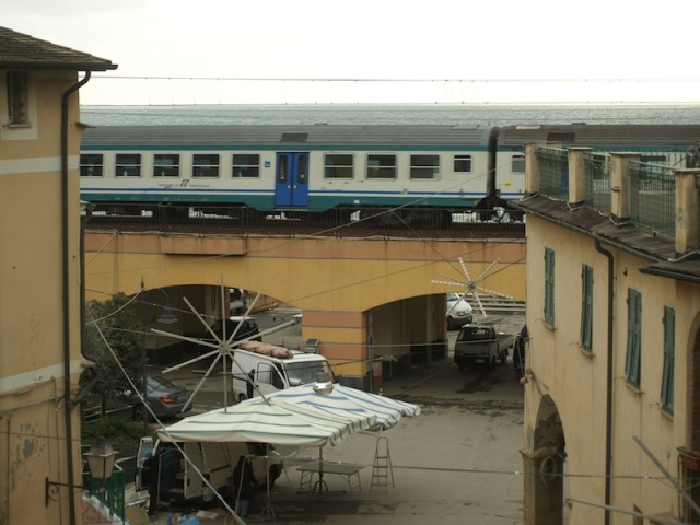 Daytime shot of village square with train, taken from our window.