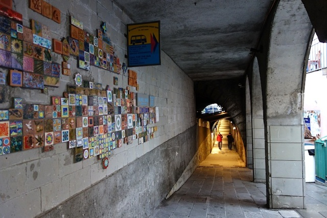 The Riomaggiore pedestrian tunnel is decorated with ceramic tiles and masonry mosaics.