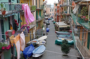 Apartments in all the towns of the Cinque Terre are brightly painted and, as is the case here, bright washing adds even more colour.
