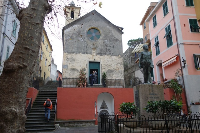 Corniglia village square dominated by a simple church.