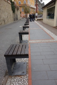 Interesting street furniture serving two purposes..providing seating and keeping cars away from the footpath.
