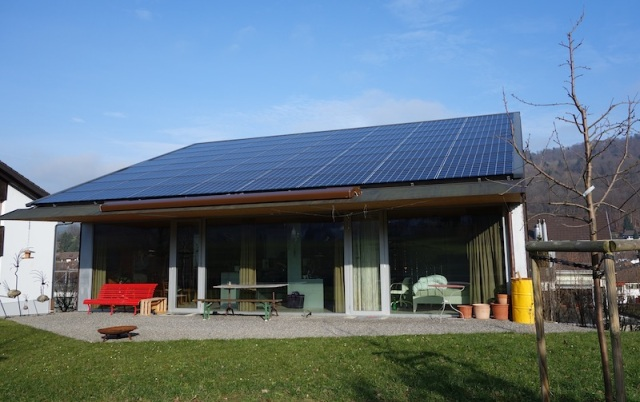 Rear view of house. The roof is made up entirely of solar panels.