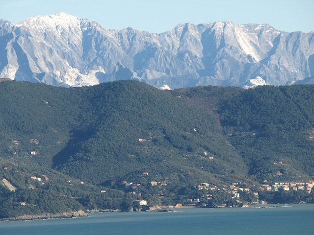 Across the bay from La Spezia. The grey rock formation is limestone and the white on the mountains is white marble, not snow.
