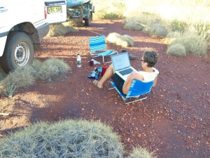 Blogging in the spinifex at day's end WA.