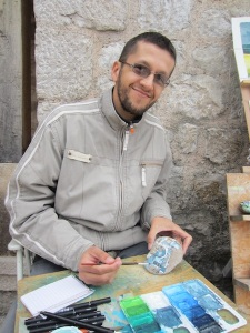 Dinonn, watercolour artist in Mostar.  We bought one of his watercolour paintings of Mostar Bridge, we will remember him every time we look at it.