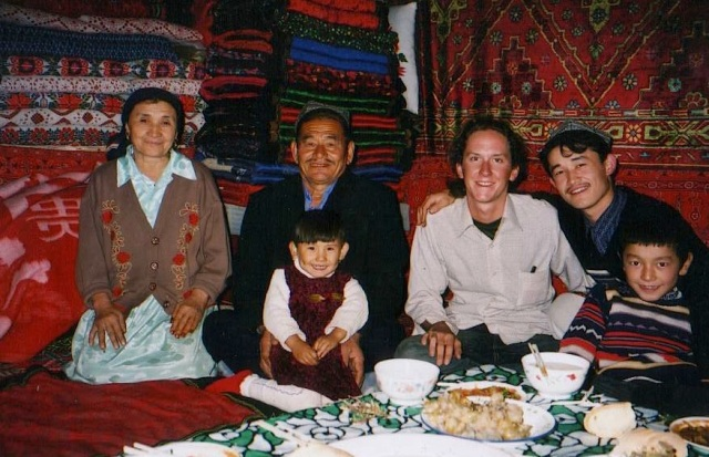 Toby sharing a meal with a Uighur family near Urumqi in western China after the Ulugh Muztagh expedition. The food was so spicy that it burnt the inside of my mouth.