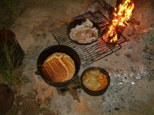 Have bush tucker like this? Camp oven bread, fish just off the hook, vegies and potatoes in the coals.